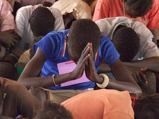 sudanese boy praying